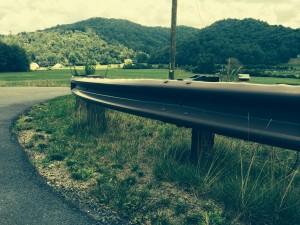 http://www.bullingtonconstruction.com/wood-rail-steel-post-guardrail/
